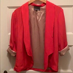 Bright coral colored blazer jacket